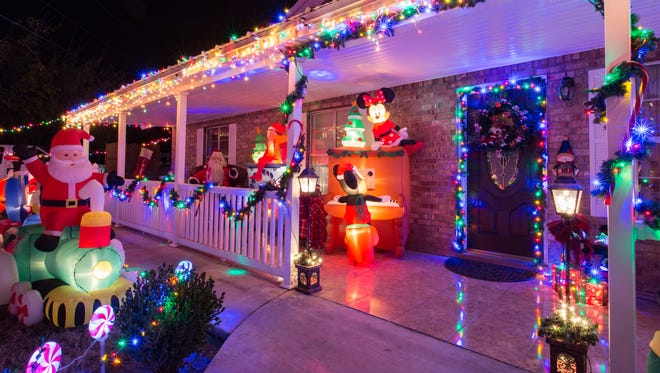 A large collection of Christmas lights are on display in front of a home located at 3930 Calle De Las Margaritas on Wednesday, Dec. 6.