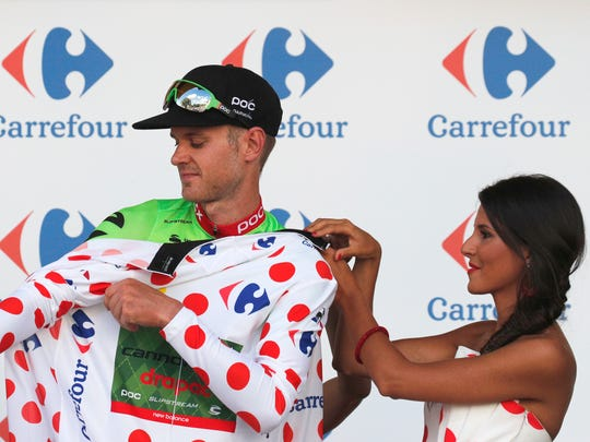 Nathan Brown of the U.S. puts on the best climber's jersey on the podium after the third stage of the Tour de France cycling race over 212.5 kilometers (132 miles) with start in Verviers, Belgium and finish in Longwy, France, Monday, July 3, 2017. (AP Photo/Christophe Ena)