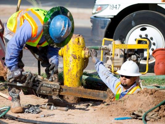 Mesa utility crew leaky fire hydrant