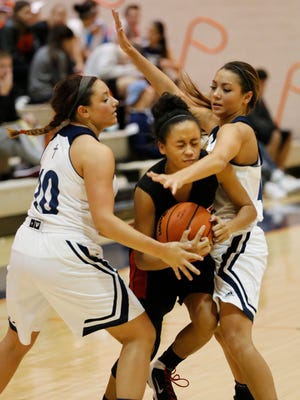 Central Catholic's Alyssa Tharp, left, and Jenny Harkcom combine to tie up Destynee Hampton of Lafayette Jeff in the semifinals of the J&C Hoops Classic Thursday, November 19, 2015, at Harrison. CC advanced to Saturday's championship with a 65-35 victory of Jeff.