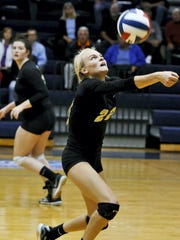 Katie Laughman helped lead Delone Catholic to four straight YAIAA volleyball titles. She's pictured here setting a ball against Central York in the 2013 league title game on Oct. 22, 2013, at Dallastown.
