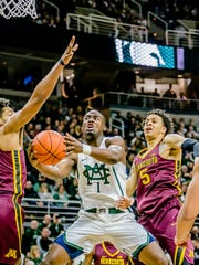 Josh Langford ,1, of MSU takes the ball to the basket through a crowd of Minnesota defenders.