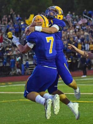 Waynesboro teammates Tom Drumsta (7) and Isaiah Kershner celebrate a first half touchdown. Shippensburg was on the road to play at Waynesboro, Friday, September 22, 2017.
