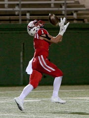 Muenster's Clay Stevens catches a touchdown pass against