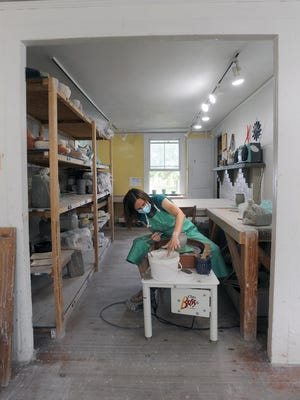 At the Hopkinton Center for the Arts Ceramics Studio, instructor Hana Reilly is seen at work. The center is offering virtual and in-person programs this summer. In-person classes are kept small to ensure social distancing in addition to following the guidelines from the Board of Health.  For more photos, visit metrowestdailynews.com/photos.