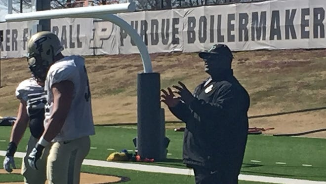 Defensive line coach Randy Melvin shouts instructions March 30, 2016, during Purdue's spring football practice.