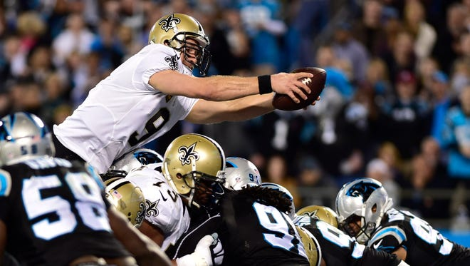 New Orleans Saints quarterback Drew Brees (9) scores a touchdown in the third quarter at Bank of America Stadium.