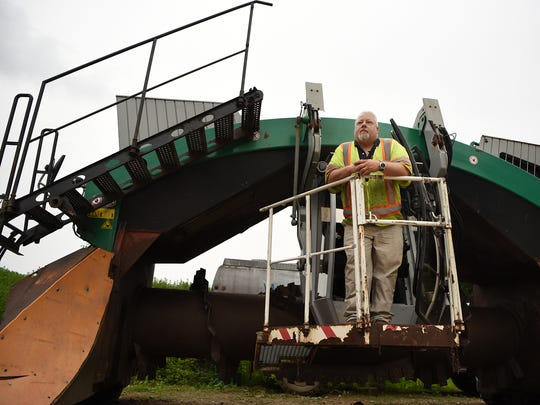 Ag Choice Organics Recycling in Andover, NJ recycles food waste which they compost, in addition to recycling other objects. Jay Fischer, who owns Ag Choice, in a compost turner on Friday June 22, 2018.
