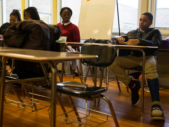 Aakhar Hollis, right, listens to guest speaker Massome Alam during a Leading Youth Through Empowerment session at Thomas Edison Charter School on Feb. 22.