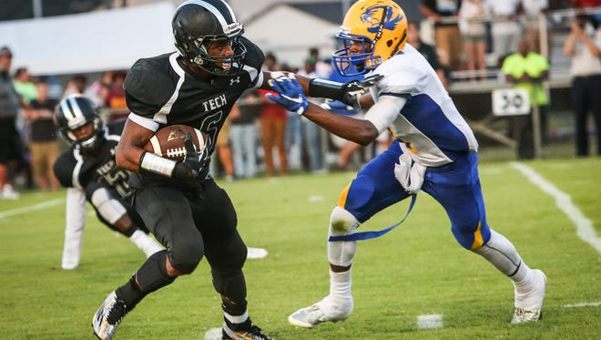 Sussex Tech's Isaiah Brown stiffarms A.I.  du Pont's Jamir Dantley last week. Brown rushed for six touchdowns in the Ravens' 61-22 victory, and Sussex Tech will be favored against Indian River on Friday.