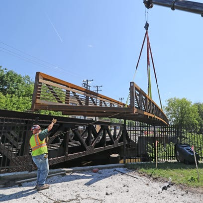 New, wider bridge lifted into place on Oak Leaf Trail in Wauwatosa