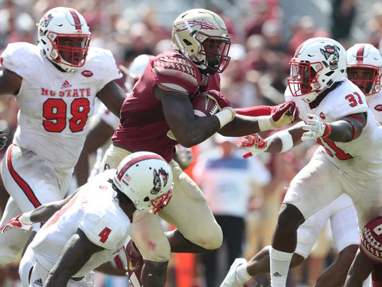 FSU's Jacques Patrick breaks through the middle against NC State during the Seminoles home opener at Doak Campbell Stadium on Saturday.