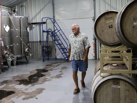 Owner Drex Vincent walks through the production room