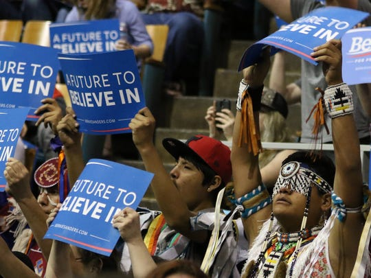 Young men representing the Confederated Tribes of Warm Springs attend a campaign rally for democratic presidential candidate Sen. Bernie Sanders at Salem Armory on Tuesday, May 10, 2016, in Salem, Ore.