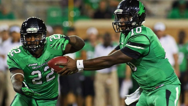 North Texas Mean Green quarterback DaMarcus Smith (10) fakes the hands off to running back Antoinne Jimmerson (22) during a game at Apogee Stadium. Western Kentucky won 55-28.