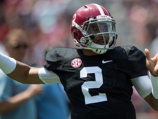 Alabama quarterback Jalen Hurts (2) throws during the