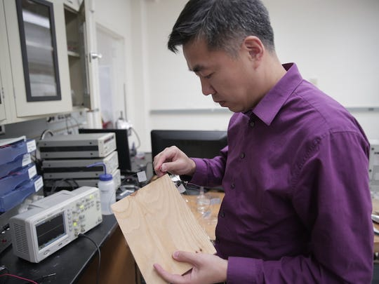 Xudong Wang is shown in his laboratory at the University of Wisconsin-Madison. He's developed a powerful new kind of flooring -- one that takes wood pulp and makes electricity by harnessing a form of static electricity.