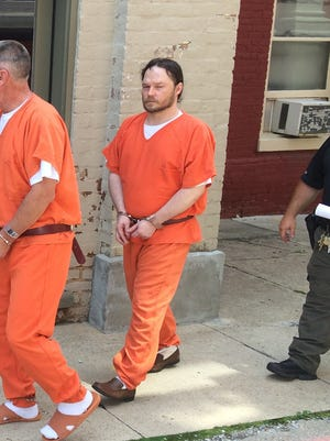 William L. Mayne Jr. is led away from the Augusta County Courthouse after being sentenced to eight years for beating his parents.