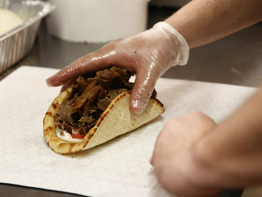 Mike Bakatsiaas prepares a gyro during Gyro Bowl at