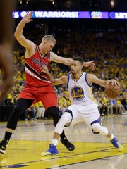Golden State Warriors' Stephen Curry in action against the Portland Trail Blazers' Mason Plumlee during the first half in Game 5 of a second-round NBA basketball playoff series Wednesday, May 11, 2016, in Oakland, Calif.