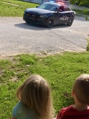 A screenshot of a video taken of Ringling Police Chief Josh Steury singing to a young girl for her birthday on Monday, April 13. Steury is continuing to sing for children throughout town who are stuck inside during their birthdays this year due to COVID-19 concerns and regulations.
