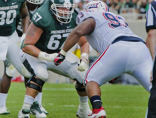 MSU offensive guard Joel Foreman (left) squares off
