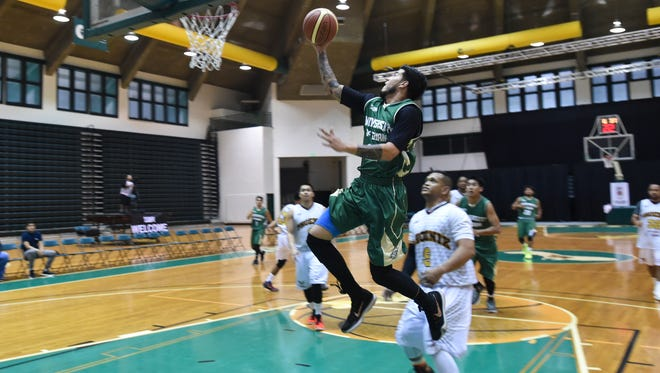 The University of Guam Tritons' Daren Hechanova drives to the hoop against the Auto Spot Phoenix Sons during a Guam Basketball Association game in April at the UOG Calvo Field House.