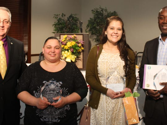 Smyrna Volunteer Banquet winners are, from left, Lifetime Service Award winner Dennis F. Johnson Sr., 2015 Parent of the Year Crystal Rary, 2015 Young Leader Alexia Grogan, and 2015 Coach of the Year Fitzroy Charles.