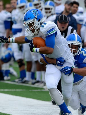 UWF's Trent Archie (2) shown in the spring football game tackling Argos receiver Ishmel Morrow, was named Monday as GSC defensive player of week. Archie and Morrow are among the seven UWF players so far to earn GSC weekly honors this season.