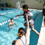Water safety lessons should begin at 6 months old, experts say