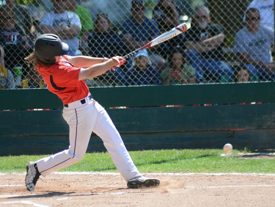 Foothill's Jordan Akins makes contact and reaches base