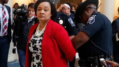 Georgian state senator Nikema Williams, an Atlanta Democrat, decries her arrest during a protest with her constituents as they demanded all votes be counted. She was one of 15 people arrested in the rotunda of the statehouse. (Nov. 14)