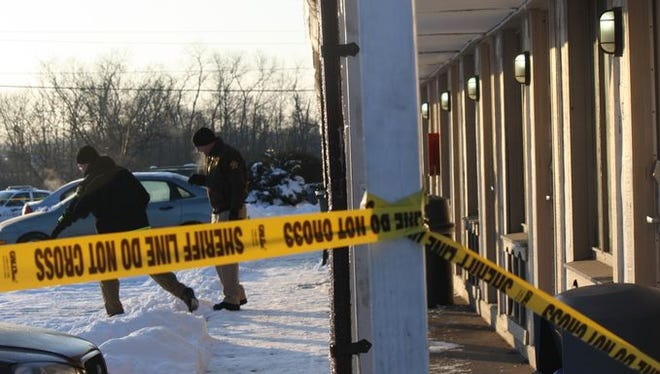 Police investigate an officer-involved shooting in the parking lot of the Florence Inn on Dream Street.