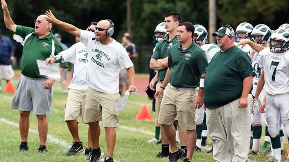 The Pleasantville coaching staff, including head coach