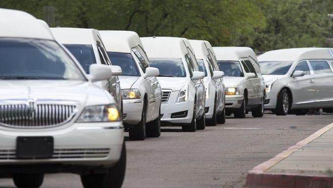 The funeral procession for a family lost in a flash flood