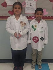 School of Science and Technology participated in career day March 1. Third-grader Aubrey Palacios (left) shared she wants to be a veterinarian and Cameron Alvarado said he wants to be a computer game programmer.