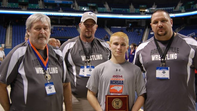 Robbinsville senior Zack Orr and the Black Knights coaches at February's NCHSAA 1-A tournament in Greensboro.