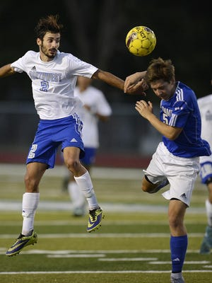 Green Bay Southwest's Calo Iannikis (2) and Green Bay Notre Dame's Josh Wiesner (5) battle for the ball during Tuesday's match at Southwest.