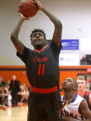 Stewarts Creek's Donovan Jackson (11) goes up for a