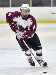 Milford's Sam Hewitt takes the puck up the ice in Wednesday's