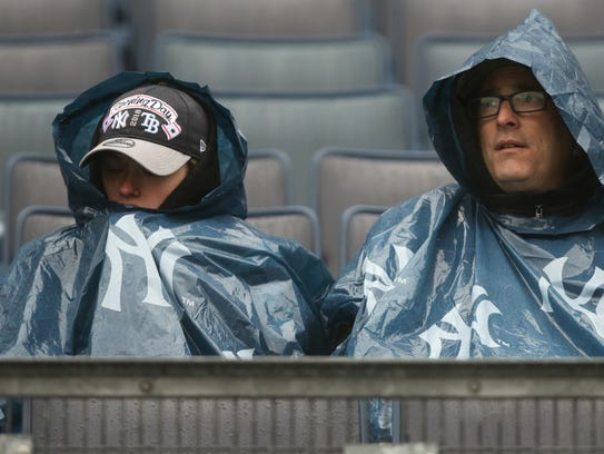 Yankee fans sit in the rain,  Tuesday, April 3, 2018.