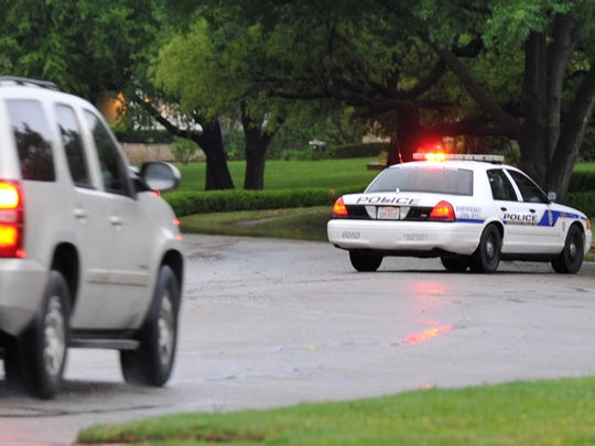 A Wichita Falls police officer diverts traffic from