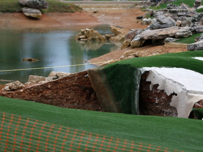 A large sinkhole opened up between the driving range