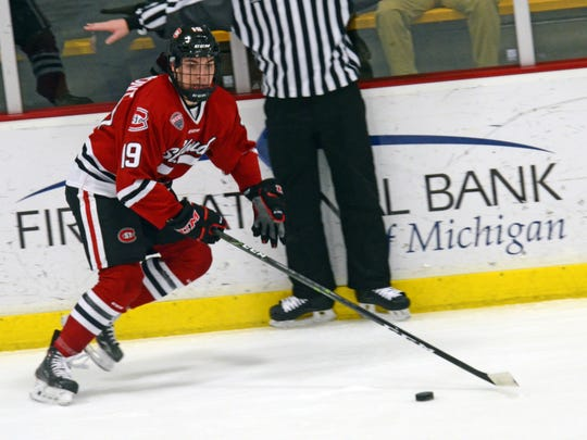 St. Cloud State forward Mikey Eyssimont handles the puck during Friday's game in Kalamazoo, Mich.