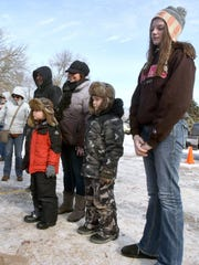 Stacy Grohall stands between her sons, Lucas and Devin, and Emily Brineger of Laramie, Wyoming all came to Jim and Linda's Lakeview Supper Club in Pipe to see a sturgeon registrations Sunday, Feb. 15, 2015.