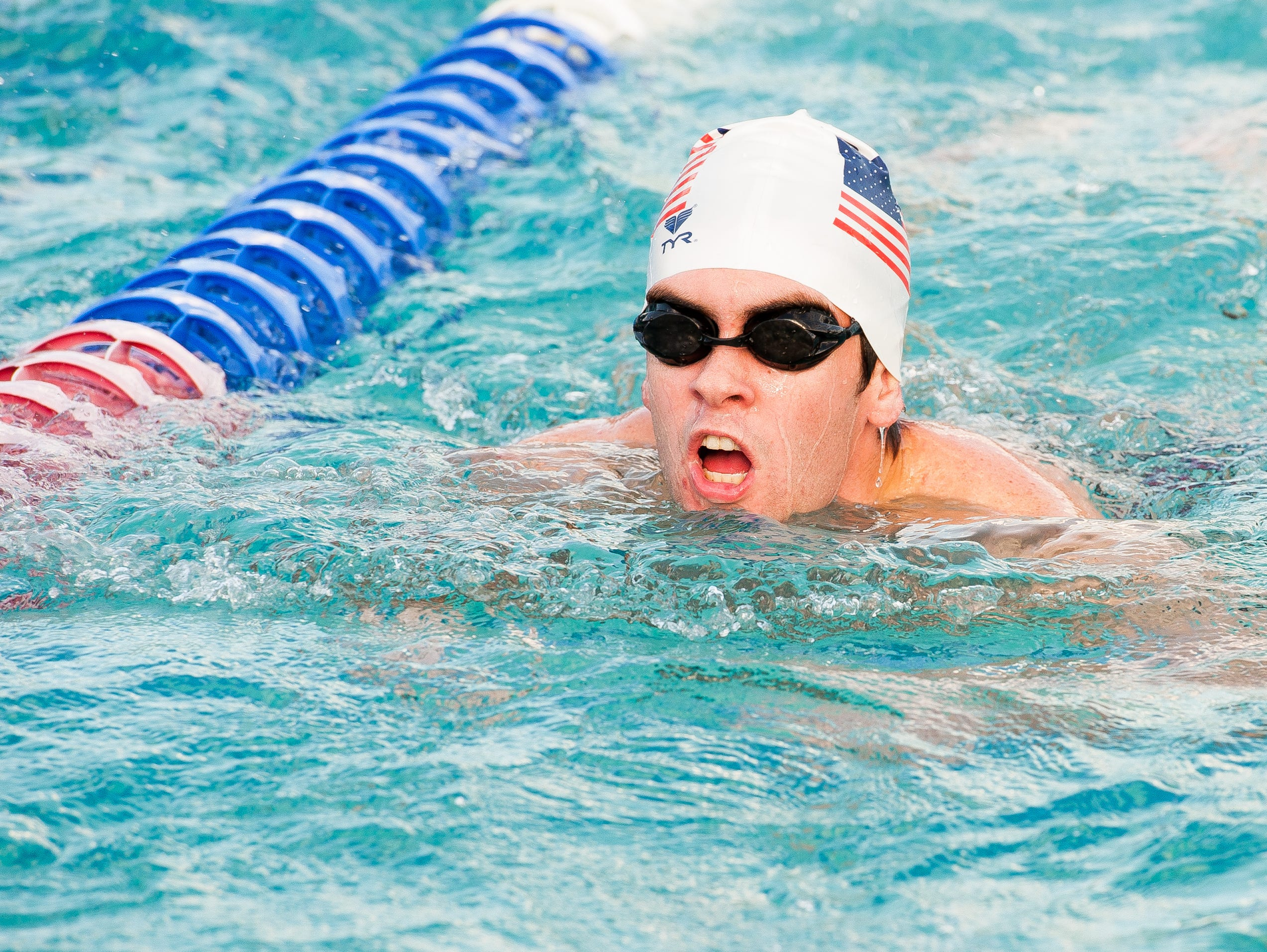 Senior Wyatt Leonard swims on Thursday, October 15, 2015 during Evangelical Christian School's swim practice held at the Fort Myers Aquatic Center in Fort Myers Fla. The team is undefeated heading into districts next week.