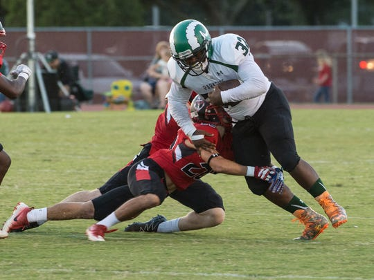 Parkside's Mike Collins (32) carries the ball during