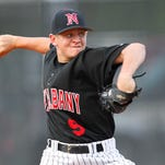 New Albany High School pitcher Chase Rudy (9) delivers a pitch to Jeffersonville High School during their game at the New Albany Baseball Complex in New Albany Indiana  .       April 20, 2016