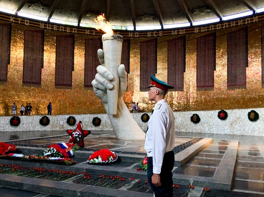 The inside view of the Battle of Stalingrad memorial in Volgograd, formerly Stalingrad, about 900 kilometers (550 miles) southeast of Moscow, Russia, Wednesday, Aug. 23, 2017. Nazi shells and Soviet soldiers' bodies are all part of the job for Sergei Kamin, who oversees construction of a 2018 World Cup stadium in Volgograd _ formerly known as Stalingrad. The regional governor hopes Germany could be drawn to play in the city during the World Cup as a symbol of peace. (AP Photo/James Ellingworth)
