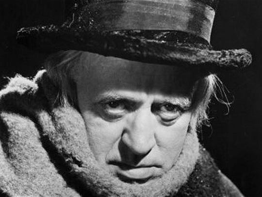 "Alastair Sim as Scrooge in the 1951 film version of ""A Christmas Carol."" The Charles Dickens book used the phrase ""dog days"" in a description of its main character."
